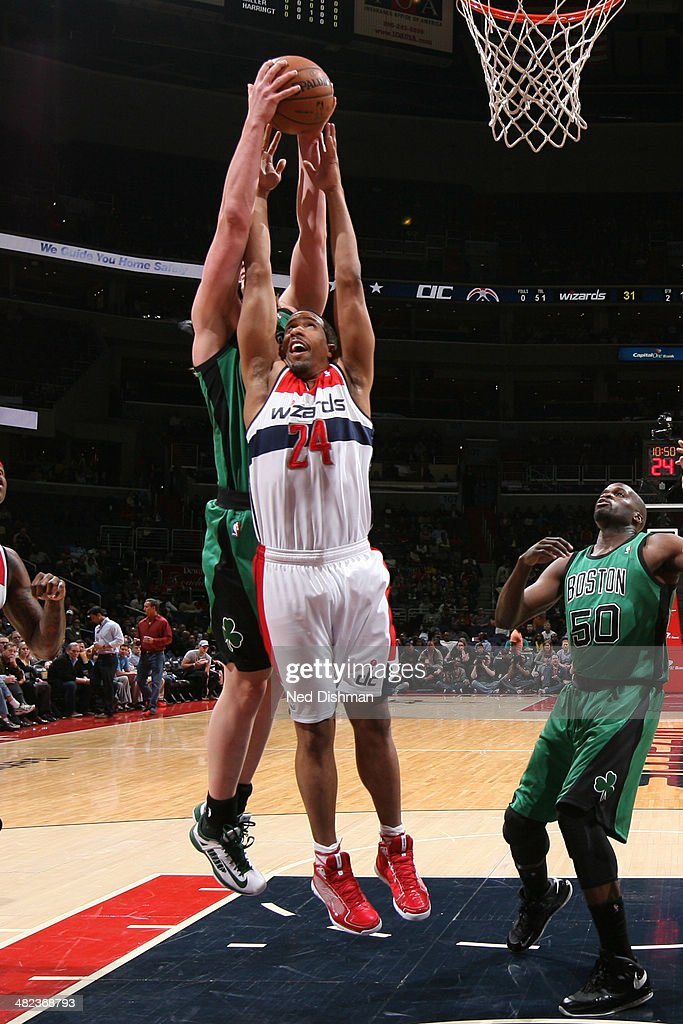 <a gi-track='captionPersonalityLinkClicked' href=/galleries/search?phrase=Andre+Miller&family=editorial&specificpeople=201678 ng-click='$event.stopPropagation()'>Andre Miller</a> #24 of the Washington Wizards battles for a rebound against the Boston Celtics at the Verizon Center on April 2, 2014 in Washington, DC.