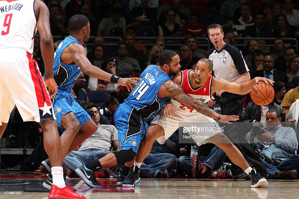 Andre Miller #24 of the Washington Wizards controls the ball against Jameer Nelson #14 of the Orlando Magic during the game at the Verizon Center on February 25, 2014 in Washington, DC.
