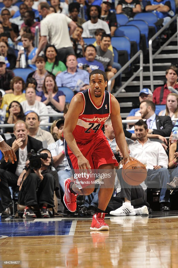 <a gi-track='captionPersonalityLinkClicked' href=/galleries/search?phrase=Andre+Miller&family=editorial&specificpeople=201678 ng-click='$event.stopPropagation()'>Andre Miller</a> #24 of the Washington Wizards dribbles up the court against the Orlando Magic during the game on April 11, 2014 at Amway Center in Orlando, Florida.