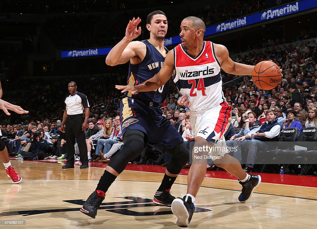 <a gi-track='captionPersonalityLinkClicked' href=/galleries/search?phrase=Andre+Miller&family=editorial&specificpeople=201678 ng-click='$event.stopPropagation()'>Andre Miller</a> #24 of the Washington Wizards drives against Austin Rivers #25 of the New Orleans Pelicans during the game at the Verizon Center on February 22, 2014 in Washington, DC.