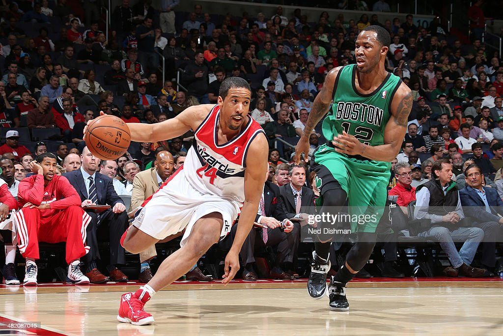 Andre Miller #24 of the Washington Wizards drives against Chris Johnson #12 of the Boston Celtics during the game at the Verizon Center on April 2, 2014 in Washington, DC.