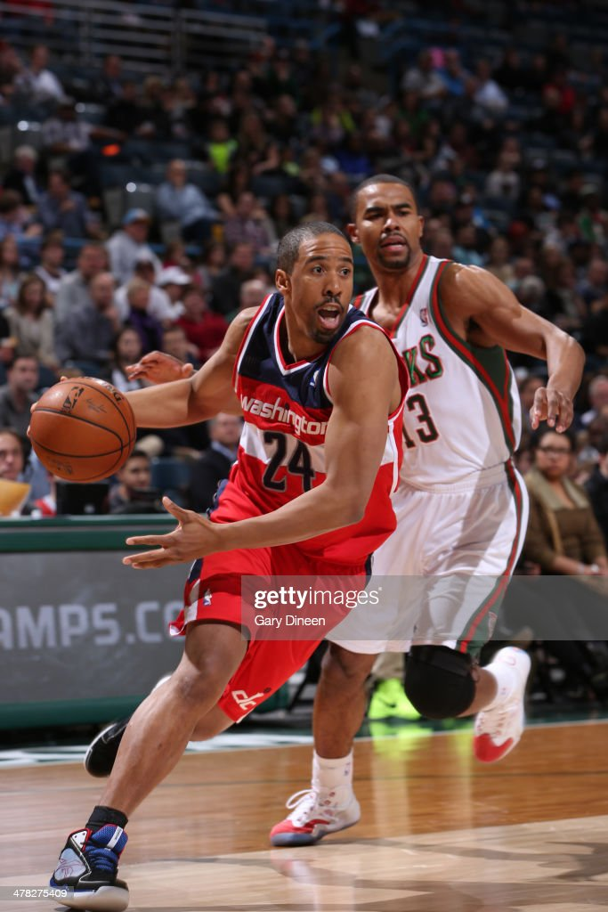 <a gi-track='captionPersonalityLinkClicked' href=/galleries/search?phrase=Andre+Miller&family=editorial&specificpeople=201678 ng-click='$event.stopPropagation()'>Andre Miller</a> #24 of the Washington Wizards drives to the basket against the Milwaukee Bucks on March 8, 2014 at the BMO Harris Bradley Center in Milwaukee, Wisconsin.
