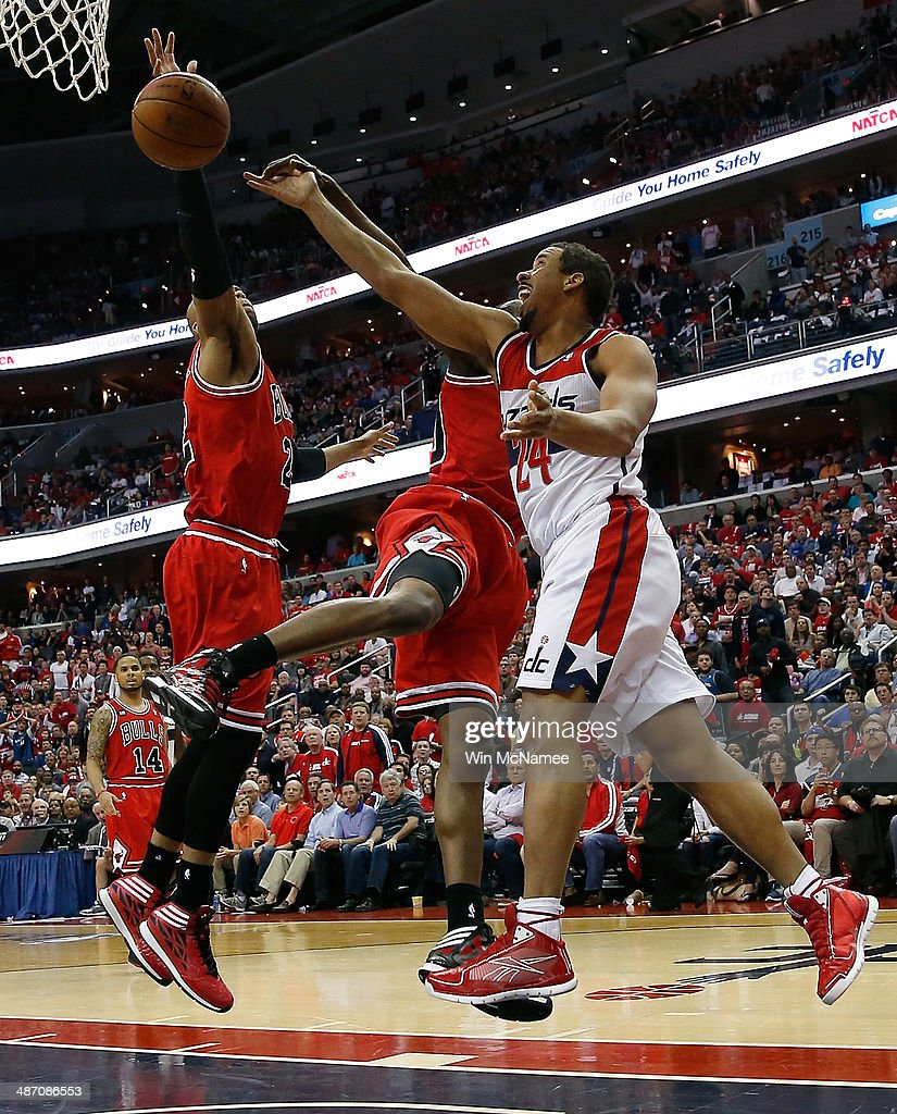 Andre Miller #24 of the Washington Wizards drives to the basket over over Taj Gibson #22 and Carlos Boozer #5 of the Chicago Bulls in Game Four of the Eastern Conference Quarterfinals during the 2014 NBA Playoffs at the Verizon Center on April 27, 2014 in Washington, DC.