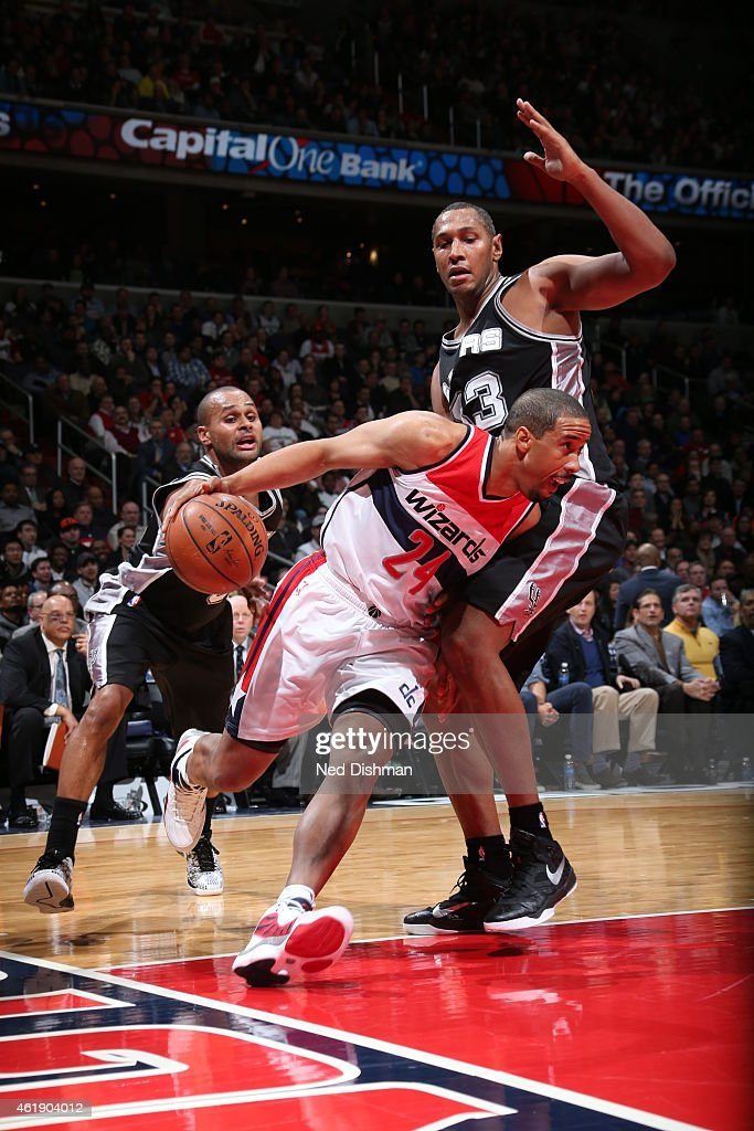 Andre Miller #24 of the Washington Wizards handles the ball against Boris Diaw #33 of the San Antonio Spurs on January 13, 2015 at Verizon Center in Washington, DC.