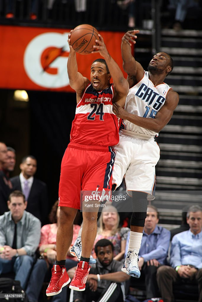 Andre MIller #24 of the Washington Wizards handles the ball against the Charlotte Bobcats during the game at the Time Warner Cable Arena on March 31, 2014 in Charlotte, North Carolina.