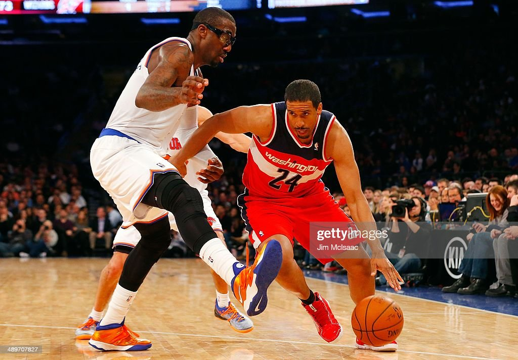 Andre Miller #24 of the Washington Wizards in action against Amar'e Stoudemire #1 of the New York Knicks at Madison Square Garden on April 4, 2014 in New York City. The Wizards defeated the Knicks 90-89.