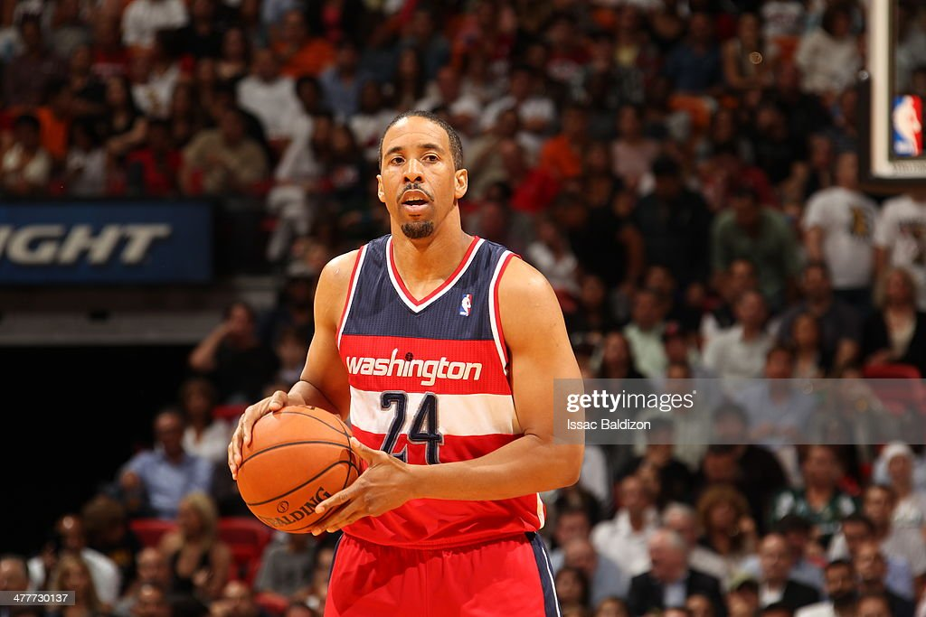<a gi-track='captionPersonalityLinkClicked' href=/galleries/search?phrase=Andre+Miller&family=editorial&specificpeople=201678 ng-click='$event.stopPropagation()'>Andre Miller</a> #24 of the Washington Wizards looks to pass the ball against the Miami Heat at the American Airlines Arena in Miami, Florida on March 10 2014.