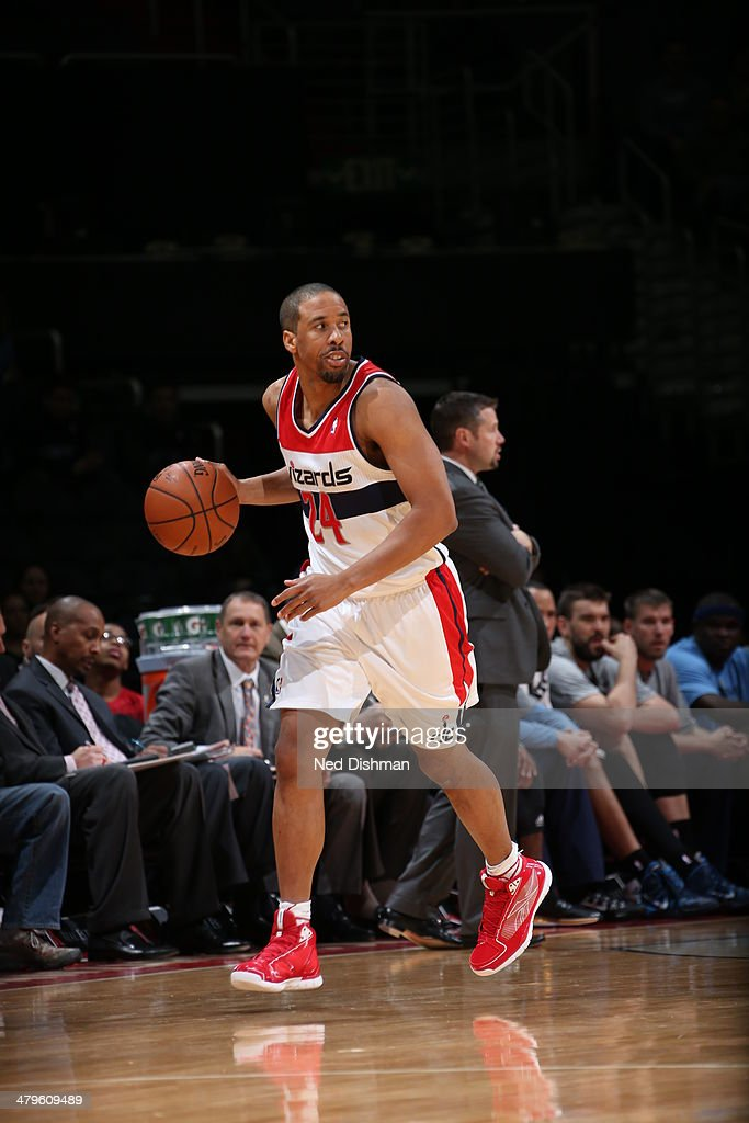 <a gi-track='captionPersonalityLinkClicked' href=/galleries/search?phrase=Andre+Miller&family=editorial&specificpeople=201678 ng-click='$event.stopPropagation()'>Andre Miller</a> #24 of the Washington Wizards moves the ball up-court against the Memphis Grizzlies at the Verizon Center on March 3, 2014 in Washington, DC.