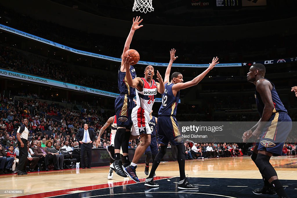 <a gi-track='captionPersonalityLinkClicked' href=/galleries/search?phrase=Andre+Miller&family=editorial&specificpeople=201678 ng-click='$event.stopPropagation()'>Andre Miller</a> #24 of the Washington Wizards shoots against Alexis Ajinca #42 of the New Orleans Pelicans during the game at the Verizon Center on February 22, 2014 in Washington, DC.
