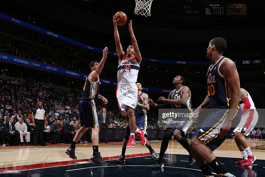 Andre Miller #24 of the Washington Wizards shoots against Enes Kanter #0 of the Utah Jazz during the game at the Verizon Center on March 5, 2014 in Washington, DC.