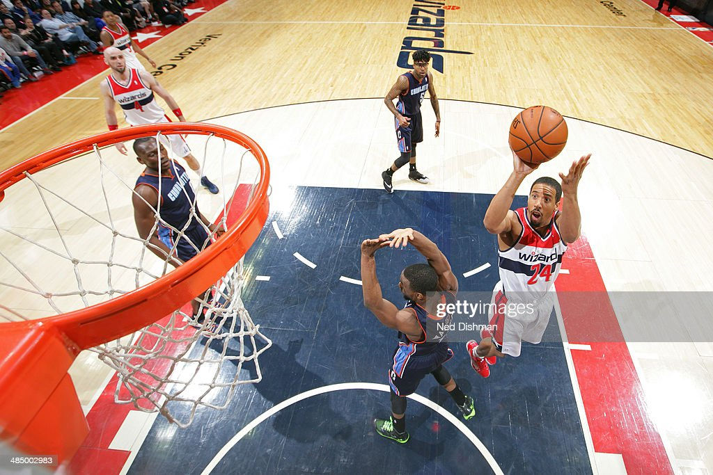 <a gi-track='captionPersonalityLinkClicked' href=/galleries/search?phrase=Andre+Miller&family=editorial&specificpeople=201678 ng-click='$event.stopPropagation()'>Andre Miller</a> #24 of the Washington Wizards takes a shot against the Charlotte Bobcats at the Verizon Center on April 9, 2014 in Washington, DC.