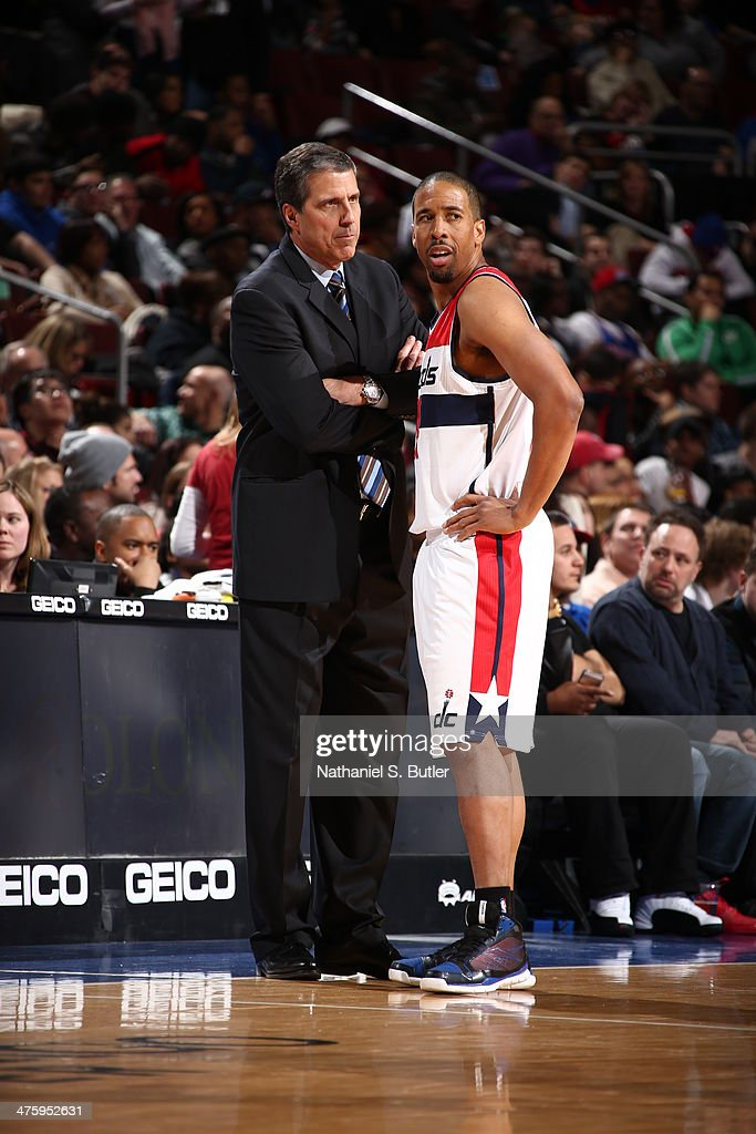 Andre Miller #24 of the Washington Wizards talks to Head Coach Randy Wittman during a game at Wells Fargo Center in Philadelphia, PA on March 1, 2014.