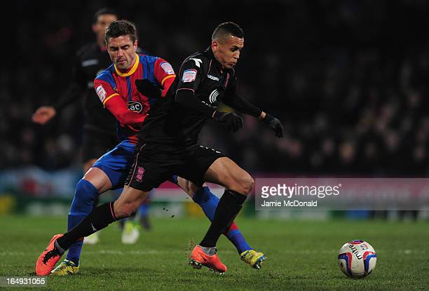 Andre Moritz of Crystal Palace battles with Ravel Morrison of Birmingham City during the npower Championship match between Crystal Palace and...
