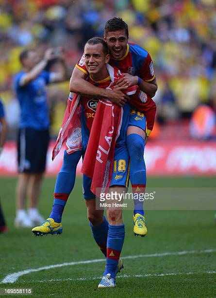 Andre Moritz of Crystal Palace celebrates with teammate Aaron Wilbraham following his team's victory in extratime during the npower Championship...