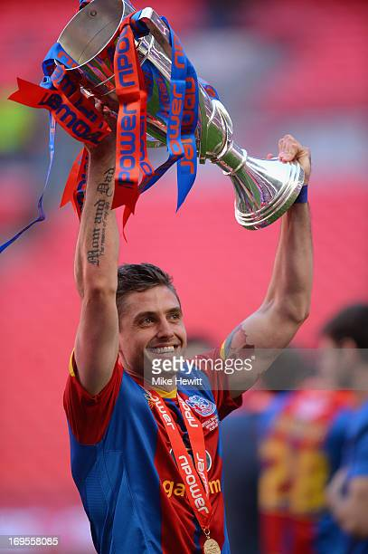 Andre Moritz of Crystal Palace celebrates with the trophy following his team's victory in extratime during the npower Championship Playoff Final...