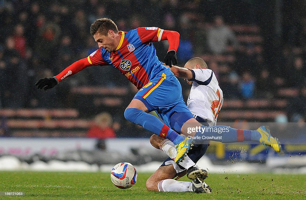 Andre Moritz (L) of Crystal Palace is tackled during the npower Championship match between Crystal Palace and Bolton at Selhurst Park on January 19, 2013 in London England.