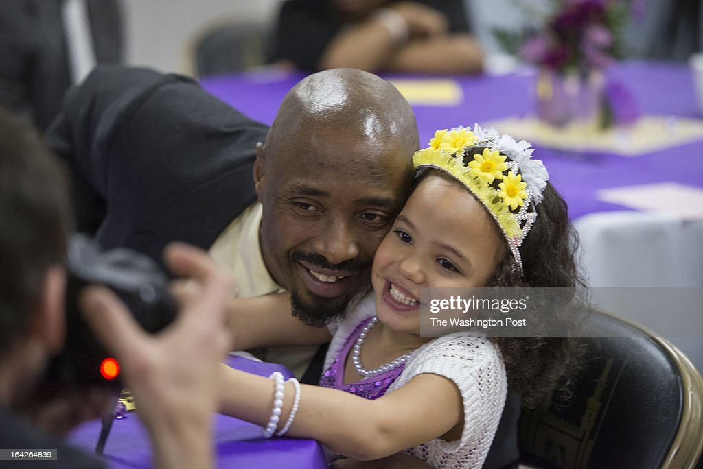 MARCH 16 Andre Morman, 42, take a quick photograph with his daughter Jhaniyika Morman, 6 during second annual Date with Dad event at the Richmond City Jail in Richmond,Virginia on March 16, 2013. Jhaniyika Morman usually visits her father in jail but is limited to seeing him behind a glass window but not on this particular day. We Profile the Date with Dad event sponsored by Camp Divas and held at the Marriott in Richmond, Virginia and particularly the Richmond City Jail. The story is about how these father-daughter dances have come under fire for excluding kids without fathers. But in this case, the dance offers a rare chance for the fathers and daughters to bond.