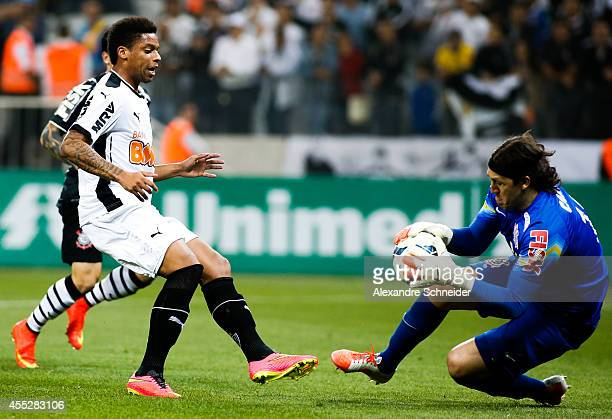 Andre of Atletico and Cassio goalkeeper Corinthians in action during the match between Corinthians and Atletico MG for the Brazilian Series A 2014 at...