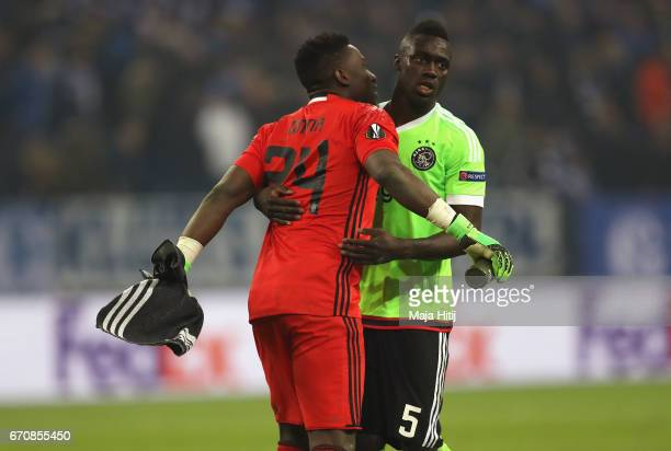 Andre Onana and Davinson Sanchez of Ajax celebrate after the UEFA Europa League quarter final second leg match between FC Schalke 04 and Ajax...
