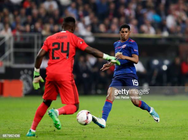 Andre Onana goalkeeper of Ajax and Marcus Rashford of Manchester United during the UEFA Europa League Final between Ajax and Manchester United at...