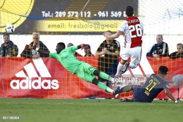 Andre Onana of Ajax Amsterdam Nick Viergever of Ajax Amsterdam Davie Selke of RB Leipzig scoresduring the friendly match between Ajax Amsterdam and...