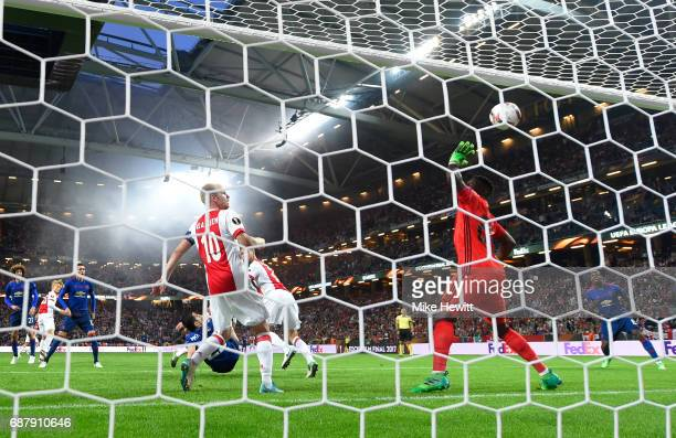 Andre Onana of Ajax attempts to save as Henrikh Mkhitaryan of Manchester United scores his sides second goal during the UEFA Europa League Final...