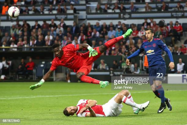Andre Onana of Ajax clears the ball under pressure from Henrikh Mkhitaryan of Manchester United during the UEFA Europa League Final between Ajax and...