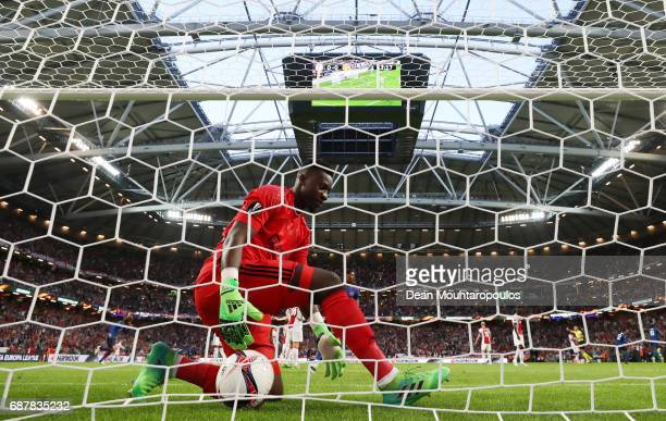 Andre Onana of Ajax picks the ball out of the net as Paul Pogba of Manchester United celebrates scoring his sides first goal during the UEFA Europa...