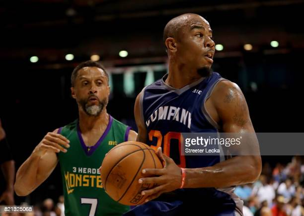 Andre Owens of 3s Company handles the ball while being guarded by Mahmoud AbdulRauf of the 3 Headed Monsters during week five of the BIG3 three on...