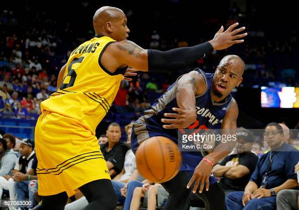 Andre Owens of 3's Company passes around Mo Evans of the Killer 3s during week seven of the BIG3 three on three basketball league at Rupp Arena on...
