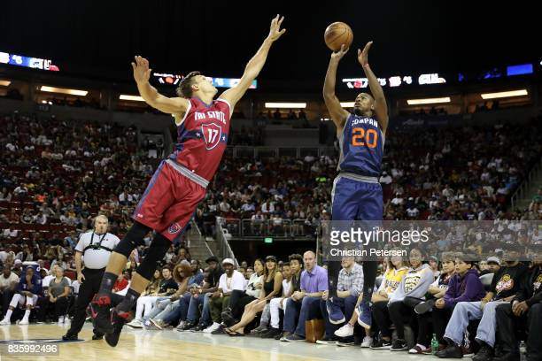 Andre Owens of the 3's Company shoots the ball in front of Lou Amundson of the TriState in week nine of the BIG3 threeonthree basketball league at...