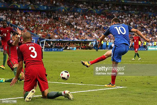 Andre Pierre Gignac of France shoots and hits the post during the UEFA Euro 2016 Final match between Portugal and France at Stade de France on July...