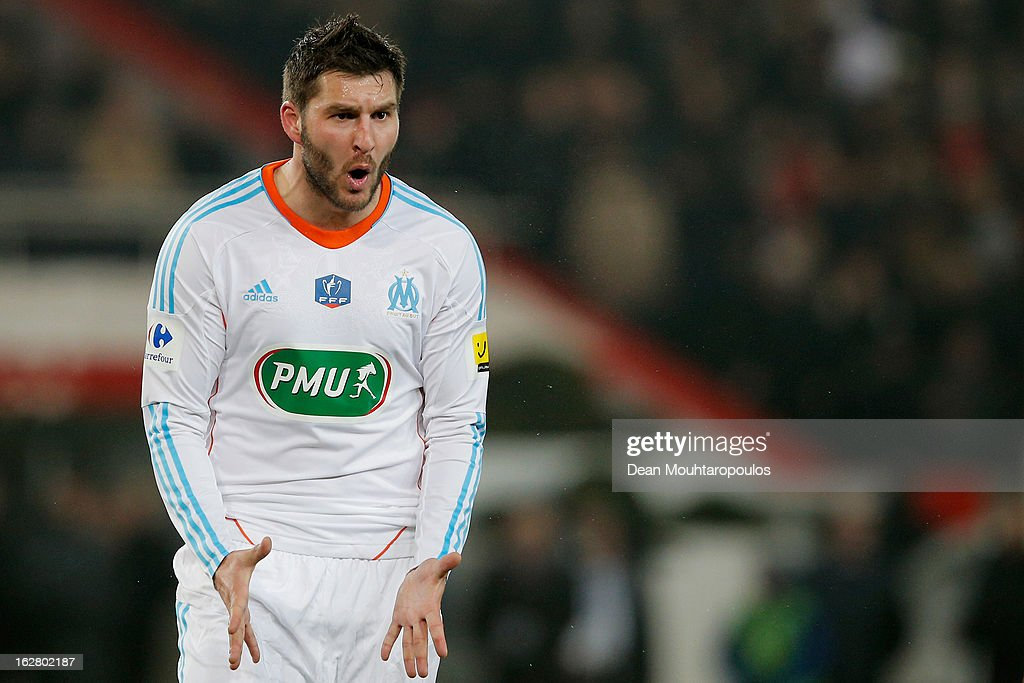 Andre Pierre Gignac of Marseille reacts to referee <a gi-track='captionPersonalityLinkClicked' href=/galleries/search?phrase=Stephane+Lannoy&family=editorial&specificpeople=2274380 ng-click='$event.stopPropagation()'>Stephane Lannoy</a> after he gives a penalty to PSG during the French Cup match between Paris Saint-Germain FC and Marseille Olympic OM at Parc des Princes on February 27, 2013 in Paris, France.