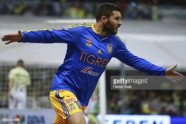 Andre Pierre Gignac of Tigres celebrates after scoring the first goal of his team during the Final first leg match between America and Tigres UANL as...