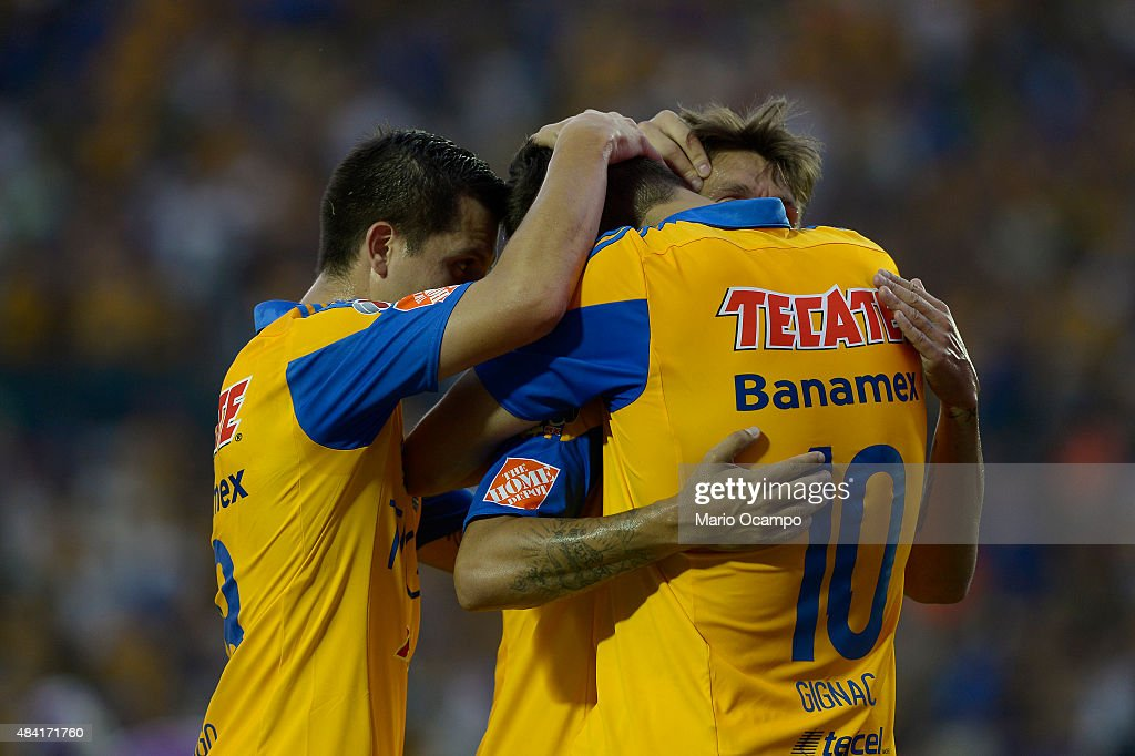 Andre Pierre Gignac of Tigres celebrates with teammates after scoring his team's first goal during a 5th round match between Tigres UANL and Chiapas as part of the Apertura 2015 Liga MX at Universitario Stadium on August 15, 2015 in Monterrey, Mexico.