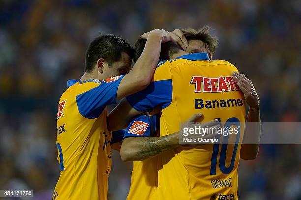 Andre Pierre Gignac of Tigres celebrates with teammates after scoring his team's first goal during a 5th round match between Tigres UANL and Chiapas...