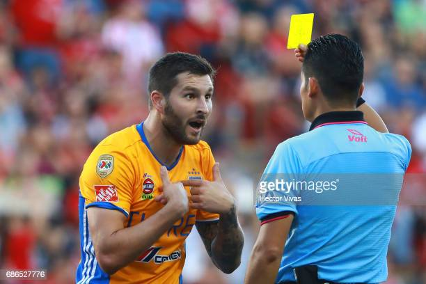 Andre Pierre Gignac of Tigres complaints to the referee Marco Ortiz after receiving a yellow card during the semi final second leg match between...