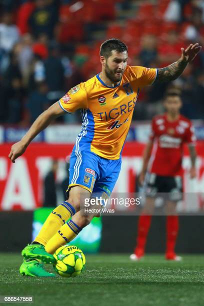 Andre Pierre Gignac of Tigres drives the ball during the semi finals second leg match between Tijuana and Tigres UANL as part of the Torneo Clausura...