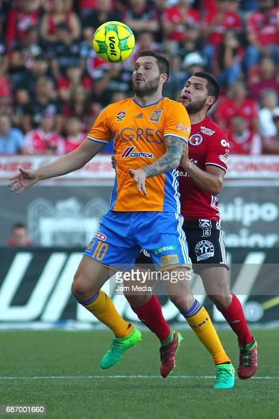 Andre Pierre Gignac of Tigres fights for the ball with Hiram Muñoz of Tijuana during the semi final second leg match between Tijuana and Tigres UANL...