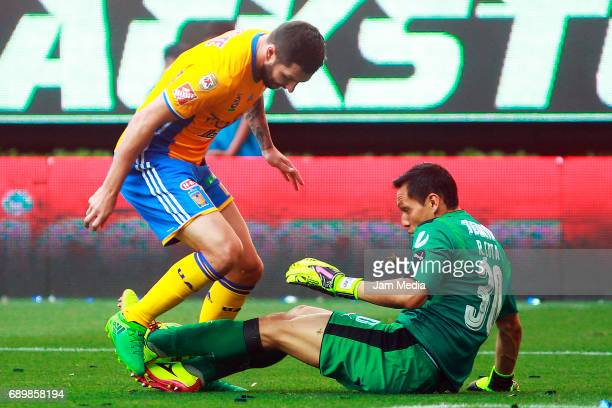 Andre Pierre Gignac of Tigres fights for the ball with Rodolfo Cota goalkeeper of Chivas during the Final second leg match between Chivas and Tigres...