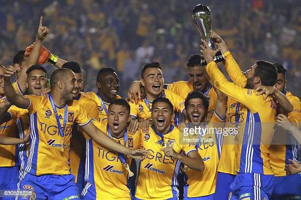 Andre Pierre Gignac of Tigres holds the champions trophy after the Final second leg match between Tigres UANL and America as part of the Torneo...