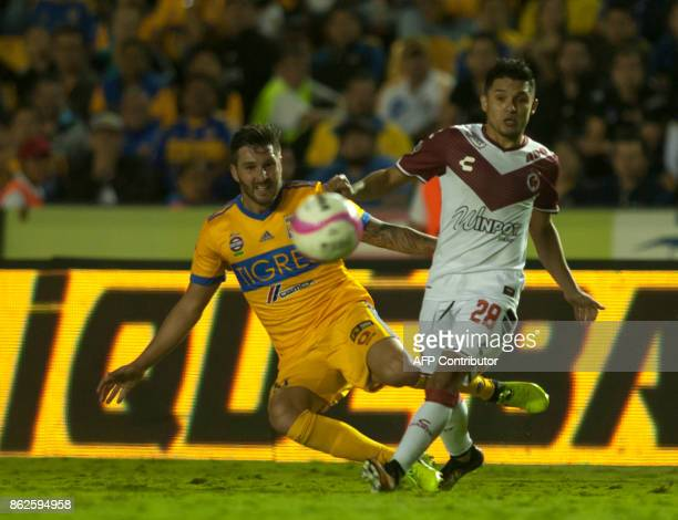 Andre Pierre Gignac of Tigres vies for the ball with Jesus Paganoni of Veracruz during the Mexican Apertura 2017 tournament football match at the...