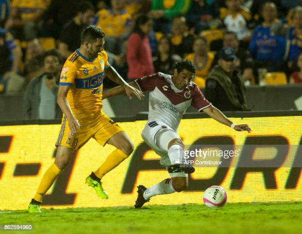 Andre Pierre Gignac of Tigres vies for the ball with Martin Bravo of Veracruz during the Mexican Apertura 2017 tournament football match at the...