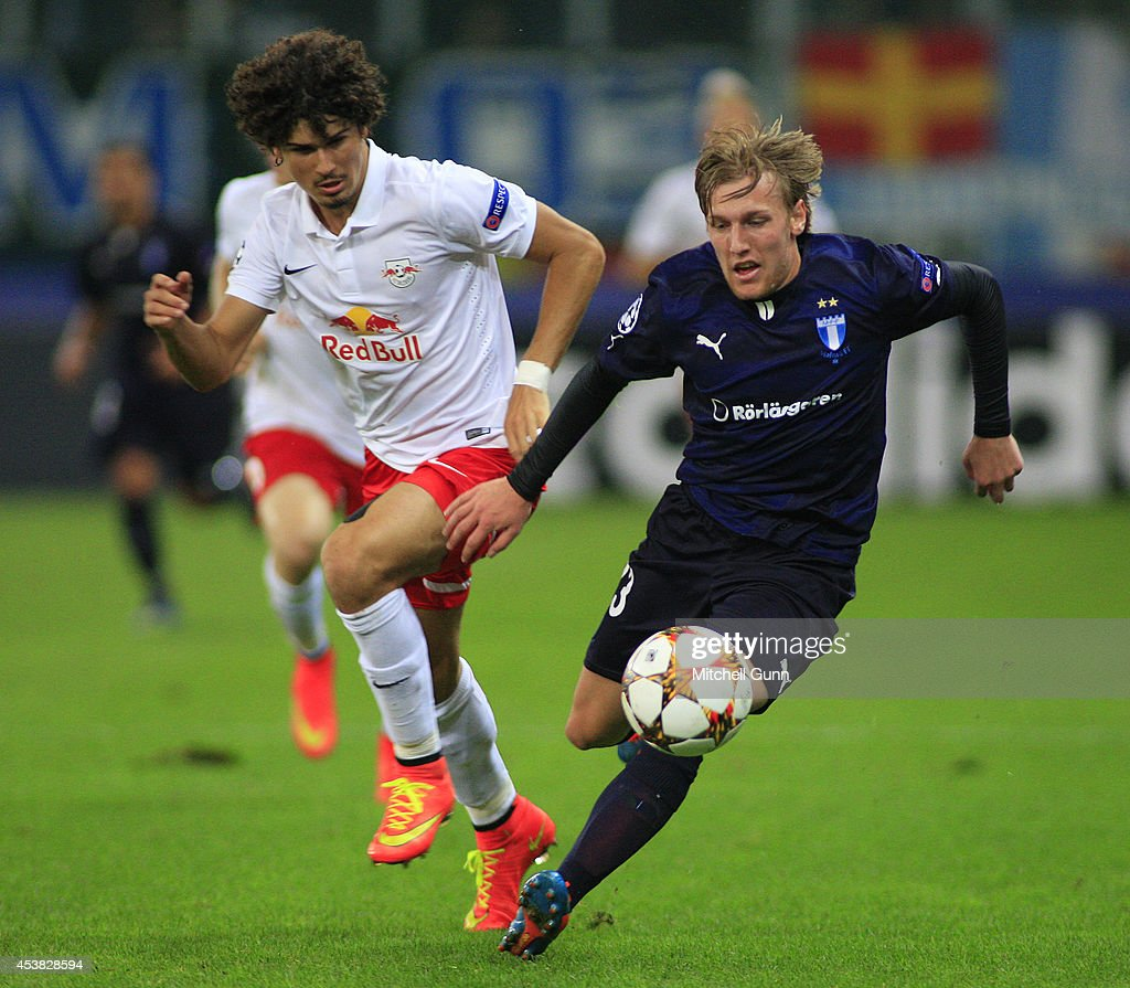 Andre Ramalho of FC Salzburg and Emil Forsberg of Malmo FF compete for the ball during the UEFA Champions League qualifying play-off at the Red Bull Arena , on August 19, 2014 in Salzburg, Austria.