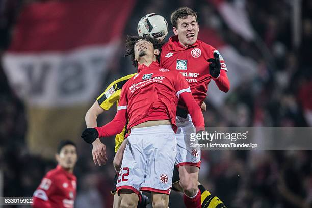 Andre Ramalho of Mainz jumps for a header with his team mate Fabian Frei and Matthias Ginter of Dortmund during the Bundesliga match between 1 FSV...