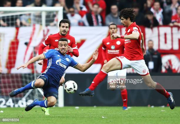 Andre Ramalho Silva of FSV Mainz 05 is challenged by Vedad Ibisevic of Schalke 04 during the Bundesliga match between 1 FSV Mainz 05 and FC Schalke...