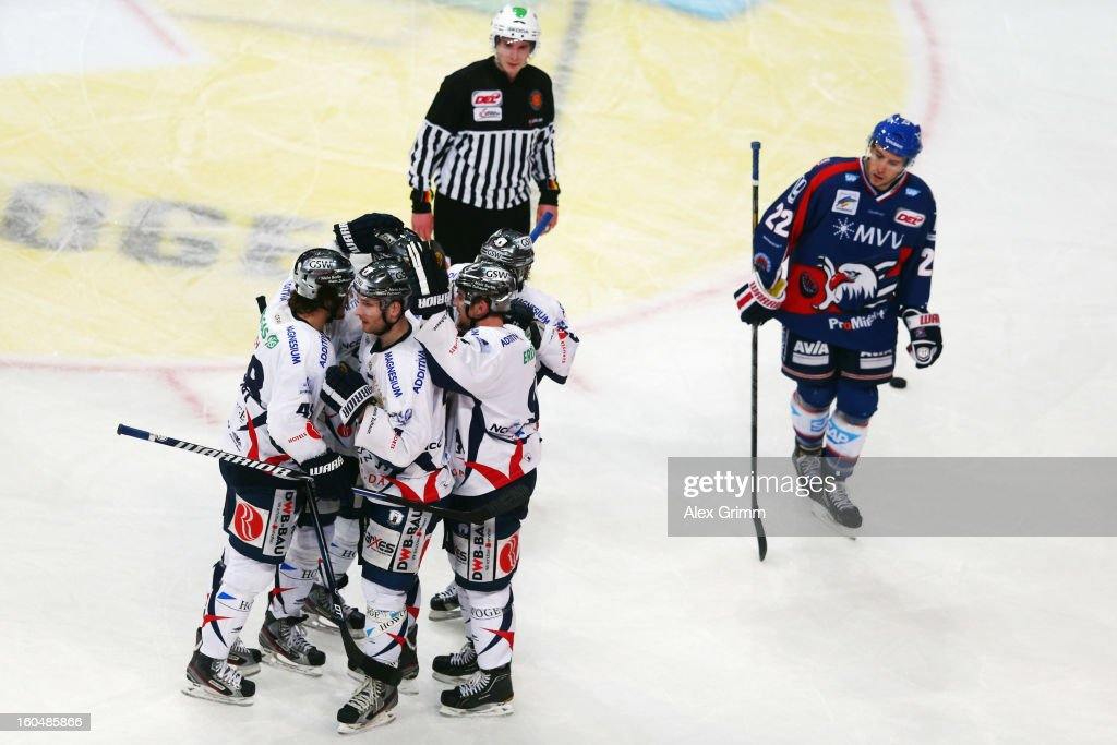 <a gi-track='captionPersonalityLinkClicked' href=/galleries/search?phrase=Andre+Rankel&family=editorial&specificpeople=684400 ng-click='$event.stopPropagation()'>Andre Rankel</a> of Berlin celebrates his team's third goal with team mates during the DEL match between Adler Mannheim and Eisbaeren Berlin at SAP Arena on February 1, 2013 in Mannheim, Germany.