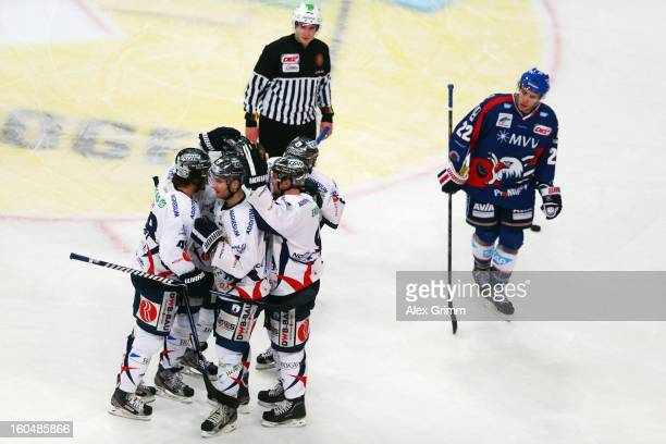 Andre Rankel of Berlin celebrates his team's third goal with team mates during the DEL match between Adler Mannheim and Eisbaeren Berlin at SAP Arena...