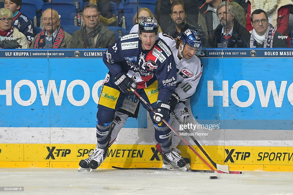 <a gi-track='captionPersonalityLinkClicked' href=/galleries/search?phrase=Andre+Rankel&family=editorial&specificpeople=684400 ng-click='$event.stopPropagation()'>Andre Rankel</a> of the Eisbaeren Berlin and <a gi-track='captionPersonalityLinkClicked' href=/galleries/search?phrase=Jon+Matsumoto&family=editorial&specificpeople=4596655 ng-click='$event.stopPropagation()'>Jon Matsumoto</a> of the Augsburger Panther during the game between the Eisbaeren Berlin and Augsburger Panther on January 10, 2016 in Berlin, Germany.