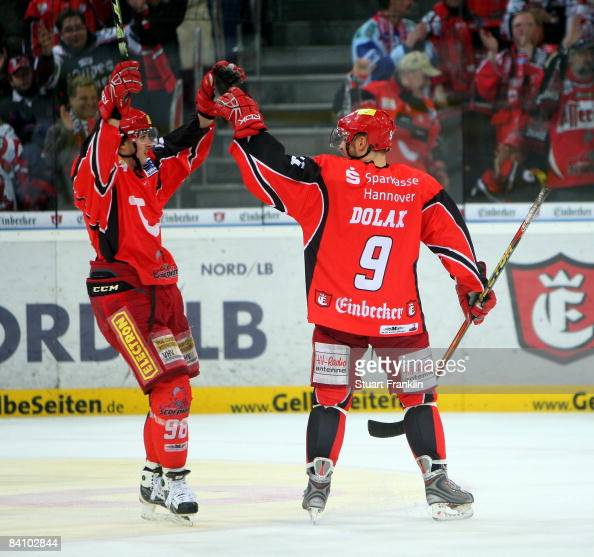 Andre Reiss and Thomas Dolak of Hannover celebrate the seventh goal during the DEL ice hockey match between Hannover Scorpions and Augsburger Panther...